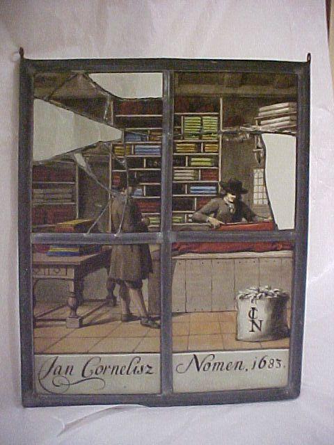 Glas-in-loodraam van de stoffenwinkel van Jan Cornelisz. Nomen