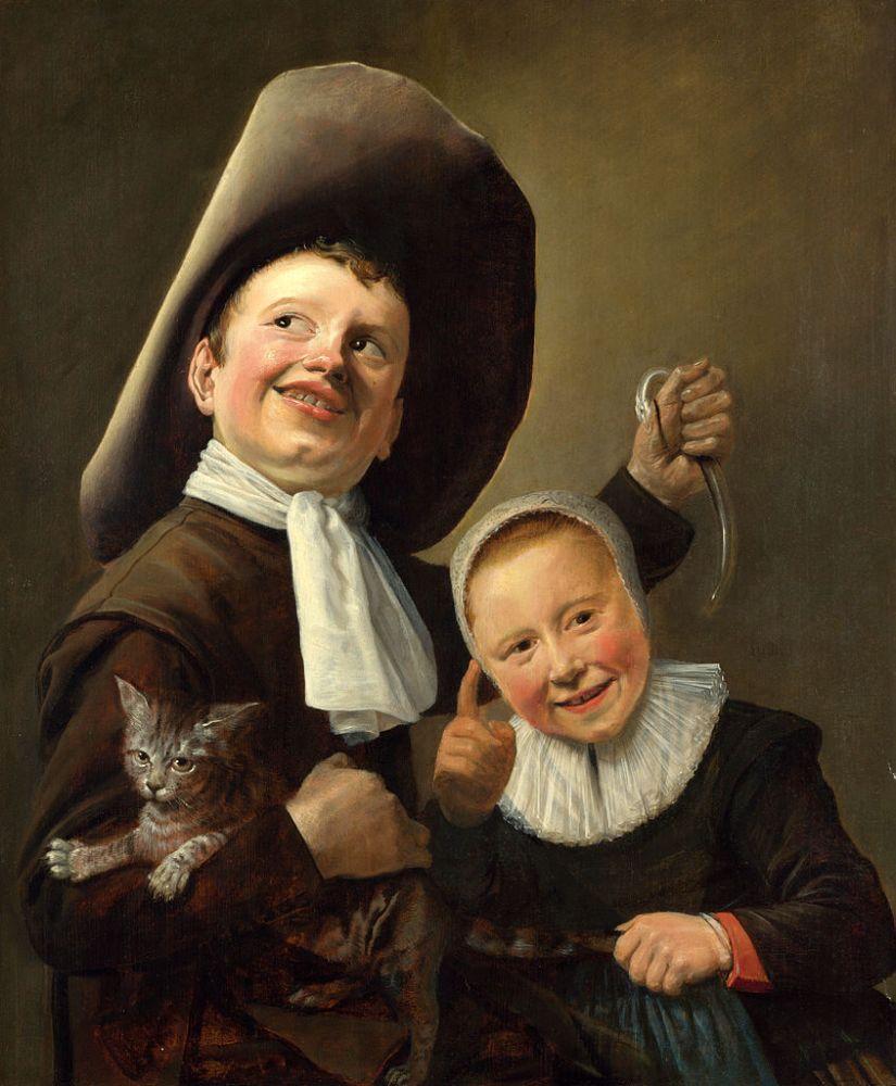 Jongen en meisje met kat en aal