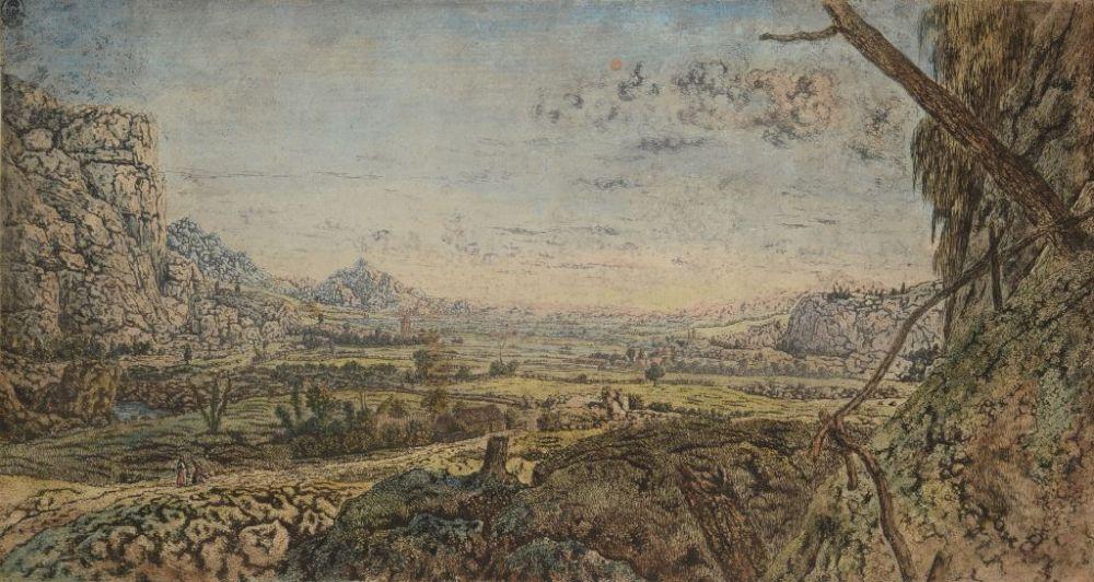 Bergvallei met omheinende velden