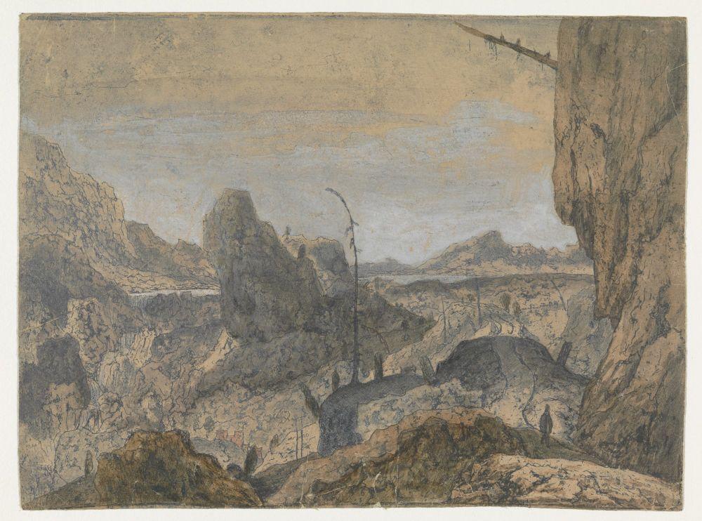 Rotsachtig landschap met wandelaar